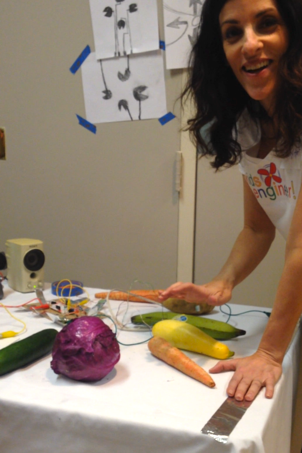 Sheryl makes music on carrots, squash and cabbage with Makey Makey, which turns everyday objects into touchpads